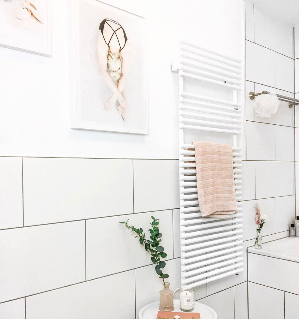 Hang your own photos in the bathroom