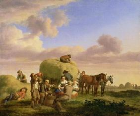 Haymakers resting in a field