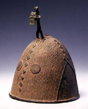 Helmet surmounted by a figure, Koma-Builsa, Ghana
