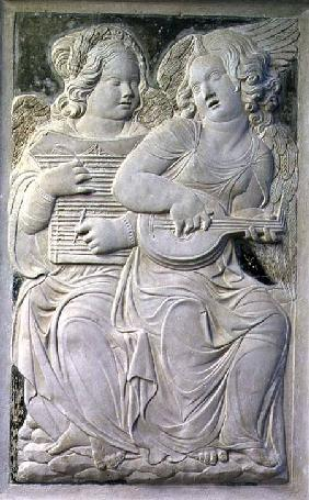 Two putti, one playing the psaltery with two quills and the other playing the mandola, from the frie
