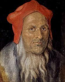 Portrait of a bearded man with a red bonnet