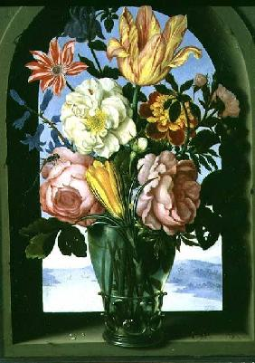 Still life of flowers in a drinking glass