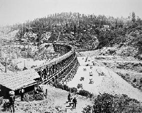 Chinese labourers working on a trestle bridge on the western slope of the Sierra Nevada mountains, 1