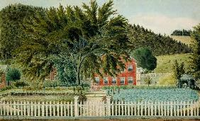 View of a Red House with a Picket Fence