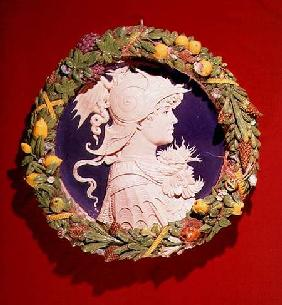 Roundel bearing a profile portrait of Alexander the Great (356-323 BC) surrounded by a garland of fo
