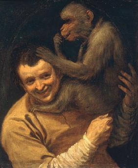 Man and Monkey picking its lice