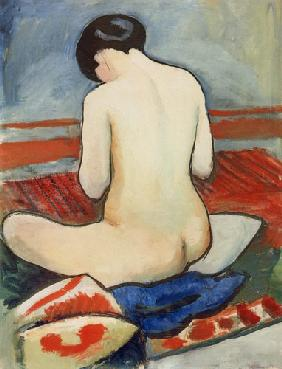 resting nude with pillow