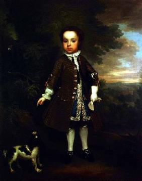 Portrait of a small boy with a spaniel and a parrot