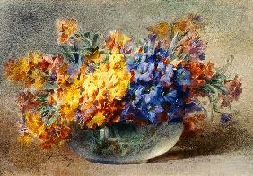 Spring flowers in a glass bowl