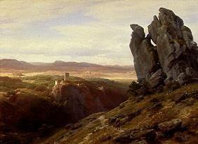 Low mountain range landscape with ruins of a castle