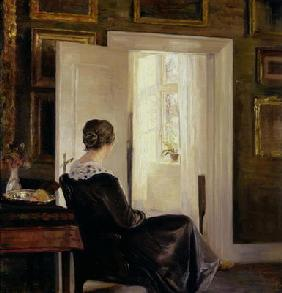 A woman seated near a door