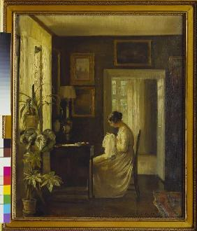 Interior with a sewing woman.