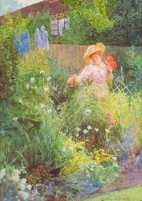 Lady picking flowers in a country garden