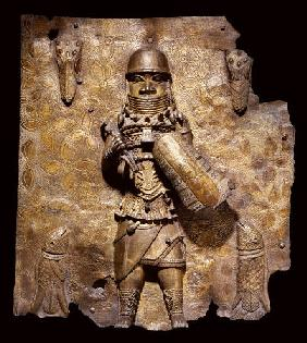 A Fine Benin Bronze Plaque In High Relief With A Warrior Chief, Full Length, In Elaborate Battle Dre
