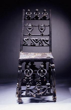A Fine Chokwe Chair Carved With Various Figures
