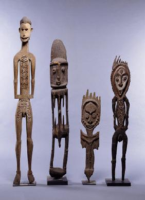 A Group Of Melanesian Figures Including An Asmat And Southern Abelam Male Figures And Karawari Cave