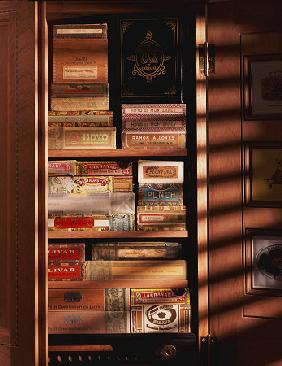 A Hand Made Cedar Armoire Containing Boxed Cigars