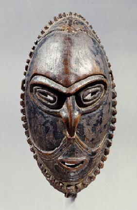 A New Guinea Mask Of Oval Form With Pierced Eyes, Mouth And Septum