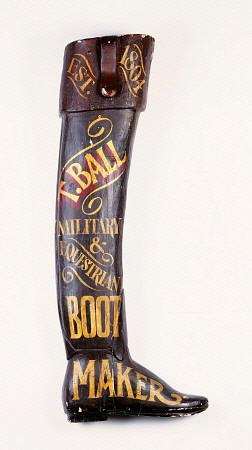 A Painted And Carved Wooden Boot Maker''s Shop Sign, 19th Century