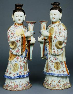 A Pair Of Famille Rose Candle Holders Modelled As Standing Ladies