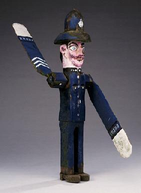 A Polychrome Wood And Metal Whirligig Modelled As A Police Sergeant, 20th Century