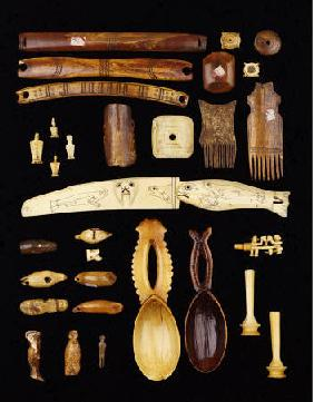 A Selection Of North American Inuit, African And Asian Ivory Carvings