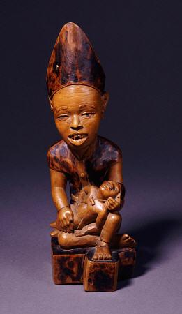 A Yombe Wood Carving Possibly Depicting A King Or Chief Presenting His Son