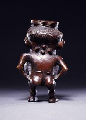 Backview Of A Wongo Cup Carved As A Female Standing Figure With Spherical Body