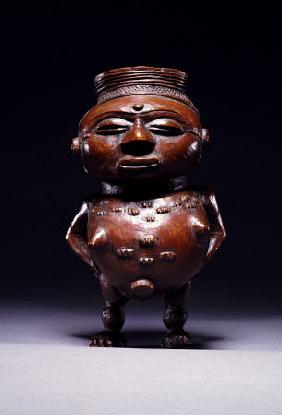 Face On View Of A Wongo Cup Carved As A Female Standing Figure With Spherical Body