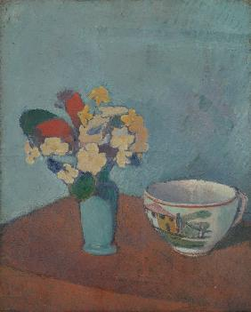 Vase with flowers and cup