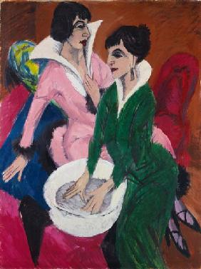 Two women with basins (the nurses)