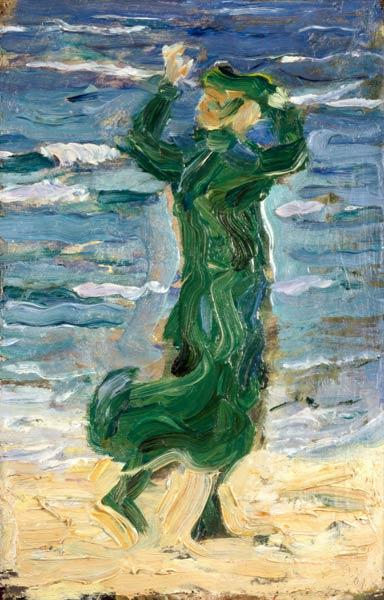 Woman in the wind by the sea