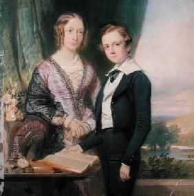 Portrait of an unknown young man standing by his mother