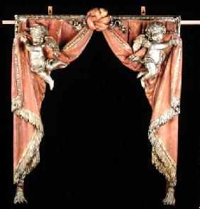 Pair of Putti supporting curtains