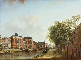 View of the Kloveniersburgwal in Amsterdam, with the Waag, and barge moored in the front of Trippenh