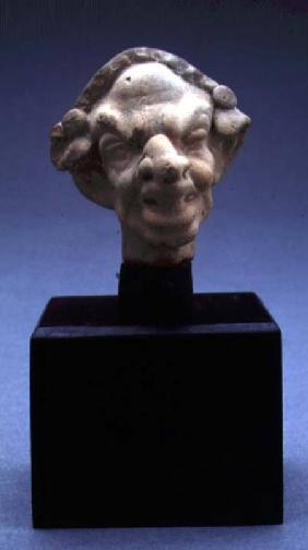 Grotesque head of a woman