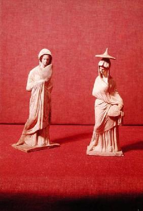 Two statues of standing women, from Tanagra