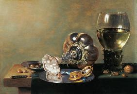 A still life with glass of wine, tazza and a pewter plate