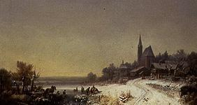 Wintry village with church at a lake