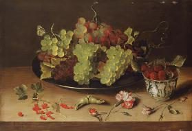 Still life with grapes and porcelain bowl