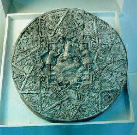 Sun disc depicting a king sitting cross-legged on a throne flanked by two angels in the centre, foun