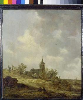 Village church in dune landscape.