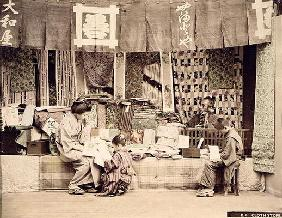 A Japanese cloth store, c.1890 (hand coloured photo)