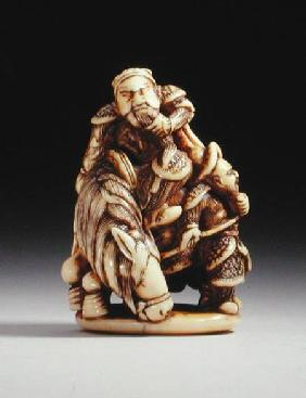 Netsuke in the form of a Chinese warrior on horseback with his attendant