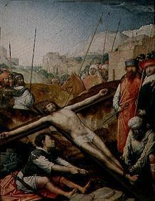Christ is nailed onto the cross.