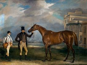 General Chasse, a chestnut racehorse being held by his trainer, with his jockey, J. Holmes standing