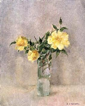 Yellow roses in a glass vase