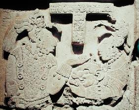 Stela depicting a woman presenting a jaguar mask to a priest, from Yaxchilan
