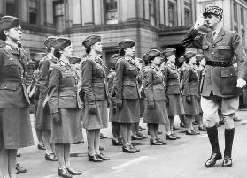 General Charles de Gaulle during review of young women of Free French Forces at Wellington barracks