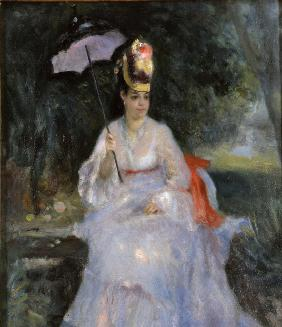 Woman with a parasol sitting in a garden